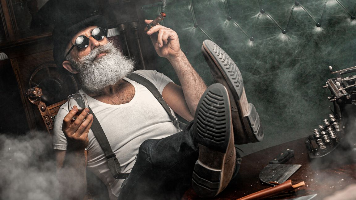 Hot octopuss affiliate with beard drinking scotch in a chair