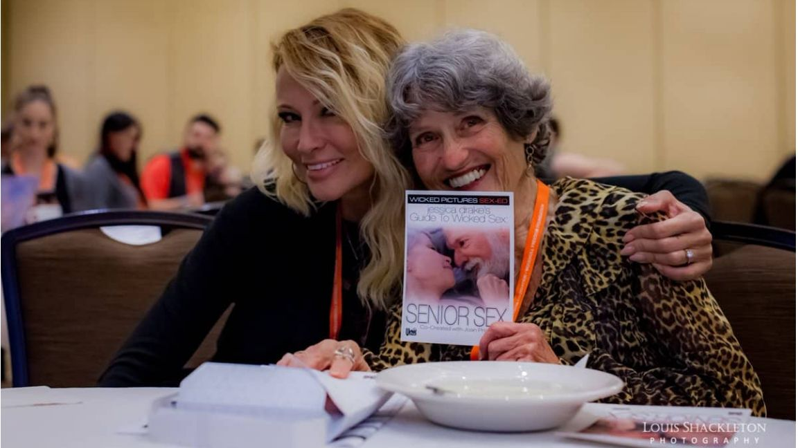 Sexperts Jessica Drake and Joan Price pose with Joan holding Jessica's book, Senior Sex