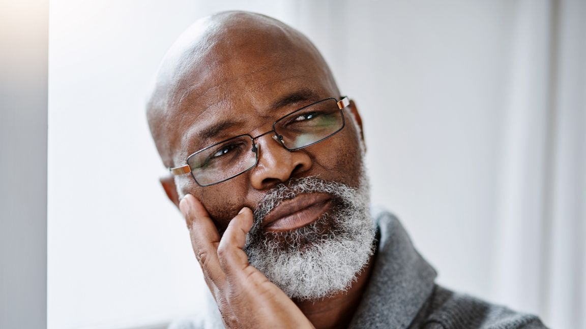 older man considering his sexual issues