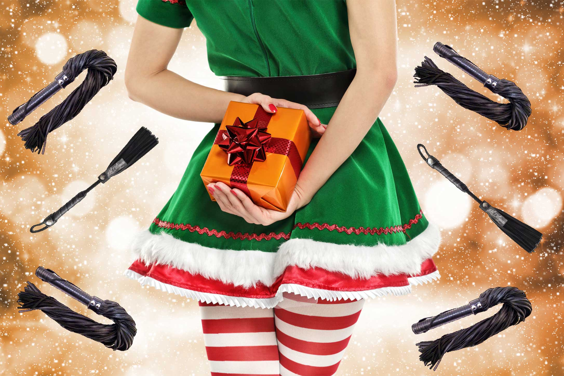Sexy elf in green holding an orange present, surrounded by leather BDSM floggers