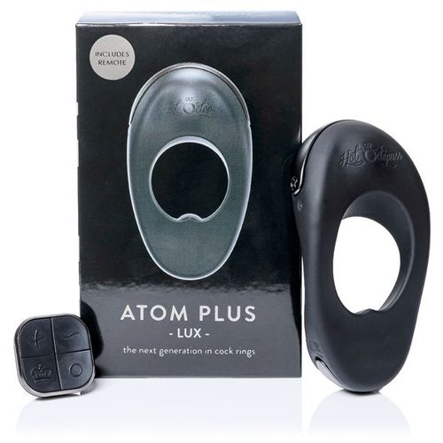 ATOM PLUS LUX Vibrating Cock Ring with Remote Control next to the Sex Toy Box