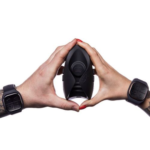 Couple showing the scale of the PULSE DUO LUX both with the male and female watch remote controls