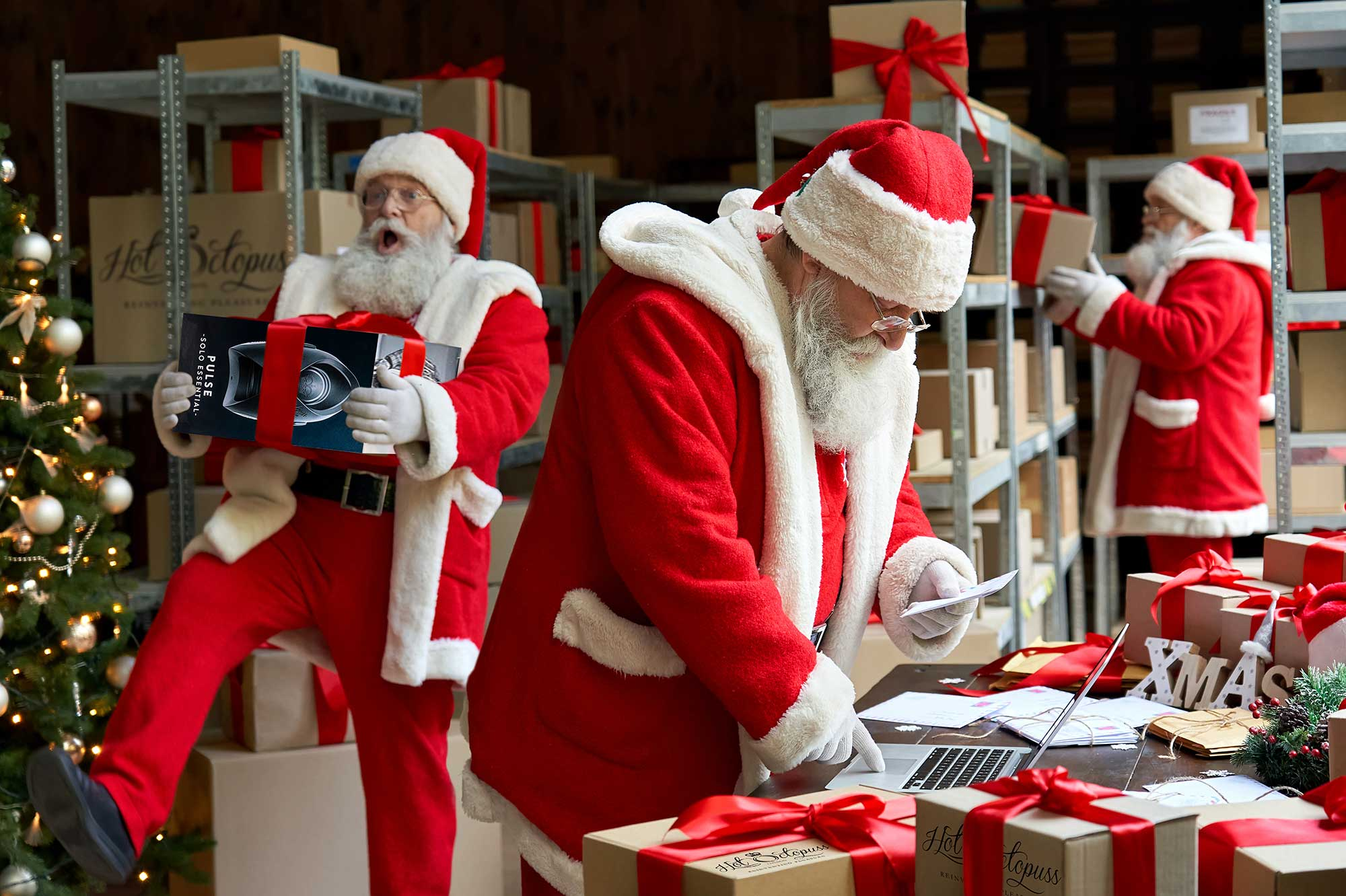 Three Santas arranging Hot Octopuss stock for delivery